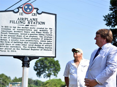 Tim Ezzell admires the historic marker erected at the Airplane Filling Station on Clinton Highway